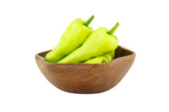 Green pepper in wooden bowl Royalty Free Stock Images