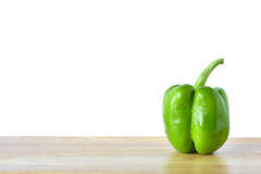 Green pepper on wooden table Stock Images