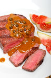 Green peppercorn beef filet mignon Royalty Free Stock Photography