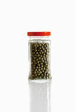 Green peppercorn in glass jar on white background Stock Photography