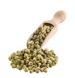 Green peppercorns. On a wooden spoon - cutout Royalty Free Stock Image