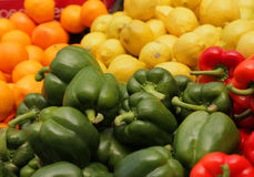 Green peppers and fruits Royalty Free Stock Photography