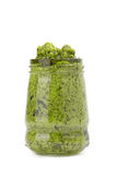 Green pesto in the glass Royalty Free Stock Images