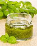 Green pesto in a jar Royalty Free Stock Photo