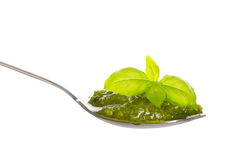 Green pesto in a spoon with basil leaf Stock Photo