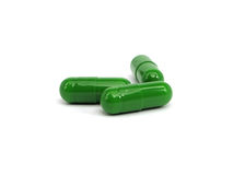 Green pharmaceutical capsules Royalty Free Stock Photo
