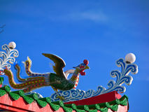 Green phoenix bird on the roof of octagon pavilion. Green phoenix bird statue on the roof of octagon pavilion Stock Photo