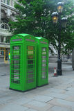 Green phone booth Stock Images