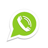Green phone handset in speech bubble icon Stock Images
