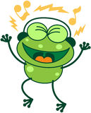 Green phone singing while listening to music. Cute green frog with long legs while clenching its bulging eyes, smiling, having fun and listening to music thanks Royalty Free Stock Photography