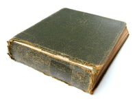 Green photo or stamp album. An old green photo or stamp album with torn cover and yellowing pages on a white background Royalty Free Stock Photography
