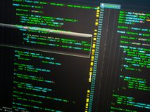 Green php code on dark blue background in code editor, macro stock photo