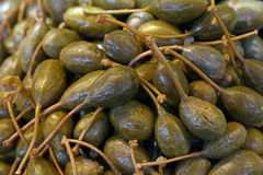 Green pickled big capers close up background Royalty Free Stock Image