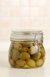Green pickled olives in glass jar Royalty Free Stock Image