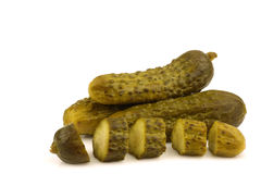 Green pickles and a cut one Royalty Free Stock Image