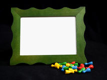 Green picture frame with pawns on black background Stock Image