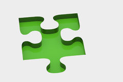 Green piece of puzzle Stock Photo