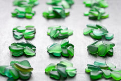 Green pieces of glass polished by the sea Stock Image