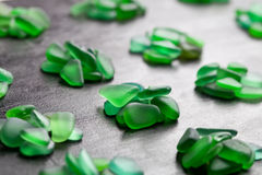 Green pieces of glass polished by the sea Royalty Free Stock Photography