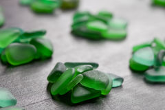 Green pieces of glass polished by the sea Stock Photos