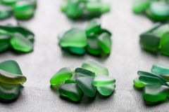 Green pieces of glass polished by the sea Stock Photo