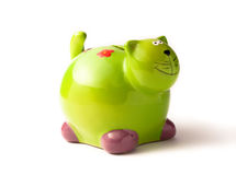 Green piggy bank. Isolated on white Royalty Free Stock Image