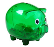 Green piggy bank. Green transparent piggy bank with few coins isolated on white Stock Photos