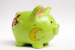 Green piggy bank. A green piggy bank isolated on white Stock Photo