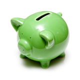 Green piggy bank. Closeup of green piggy bank isolated on white background Stock Photography