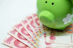Green piggy bank with China currency Stock Images