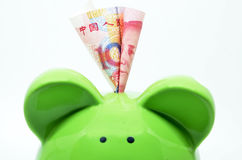 Green piggy bank with China currency Stock Photo