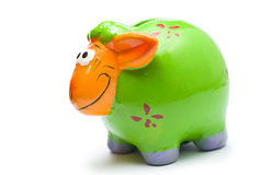 Green piggy bank isolated on white. Green piggy bank (sheep) isolated on white Stock Images