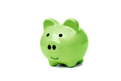 Green piggy bank. Isolated on white Stock Photo