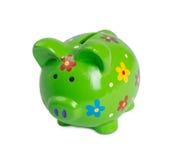 Green piggy bank for money. Green piggy bank or money box isolated Stock Photos