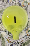Green piggy bank standing on dollar bills Royalty Free Stock Photos