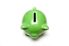 Green piggy bank on white. Looking down on green ceramic piggy bank, isolated on white background Royalty Free Stock Photography