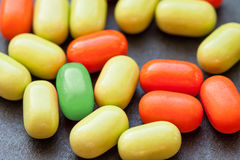 Green pill over many others. Royalty Free Stock Photos