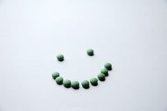 Green Pill Smile stock photos