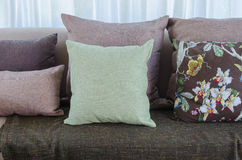 Green pillow with blanket on sofa in living room Stock Images