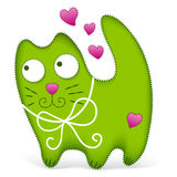 Green pillow cat with pink hearts Stock Photo