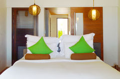 Green pillows in bedroom. In resort royalty free stock photography
