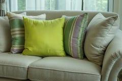 Green pillows on modern sofa Royalty Free Stock Image