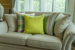 Green pillows on modern sofa Royalty Free Stock Photo