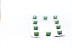 Green pills in blister Stock Photo