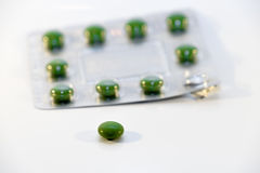 Green pills in blister Royalty Free Stock Photography