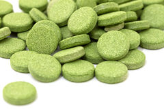 Green pills Stock Images