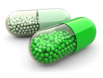 Green pills and drugs on white  background. Medical conc Stock Images