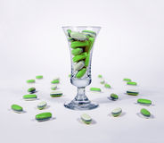 Green pills in a glass. Green tablests - pills in a glass Stock Photos