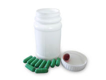 Green pills and pill bottle Royalty Free Stock Images