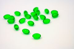 Green pills soft gel capsule isolated on white Stock Photography